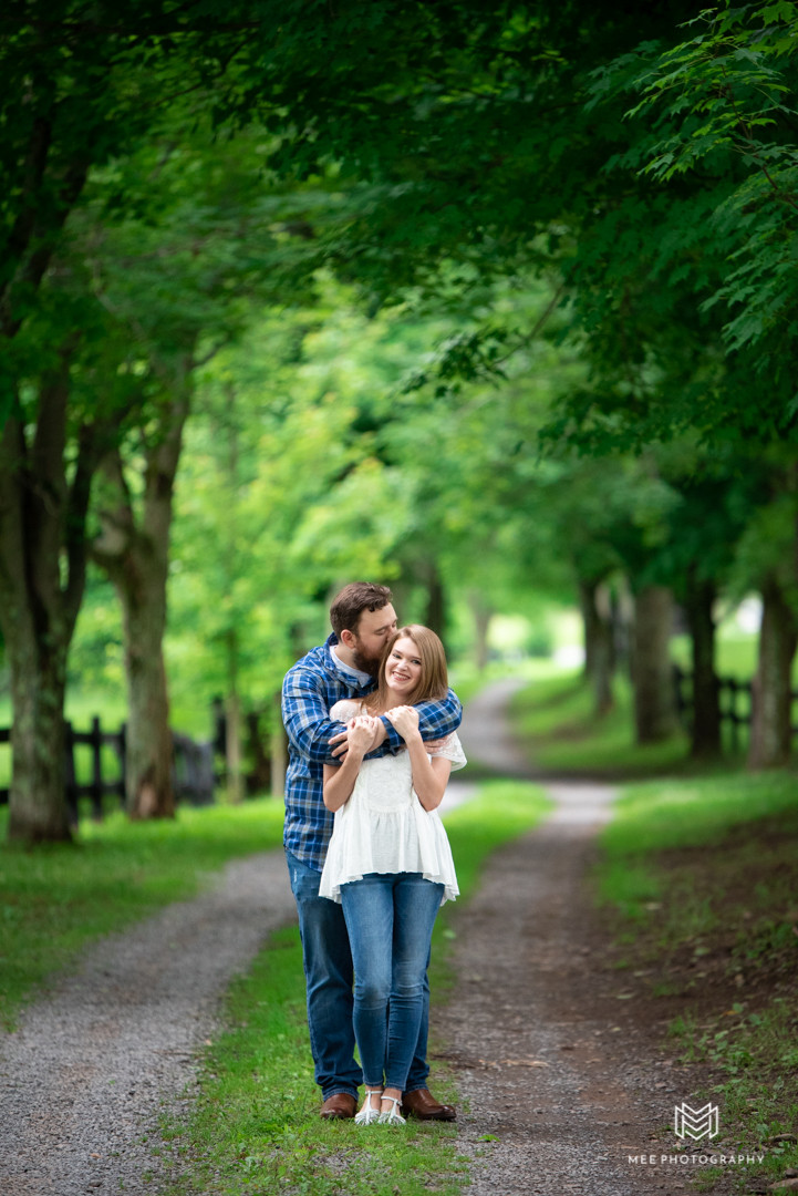 Couple kissing during their engagement photo session at Chanteclaire Farms in Maryland.