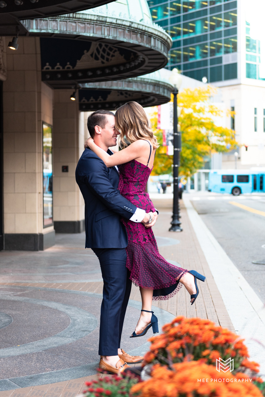 Guy picking up his fiance in downtown Pittsburgh with skyscrapers in the background