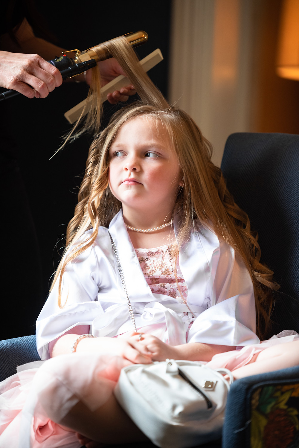 Flower girl getting her hair done at the Omni William Penn Hotel in Pittsburgh