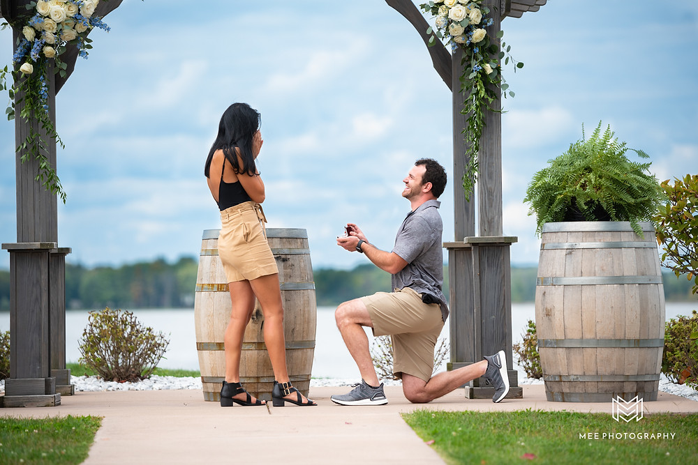 Guy proposing under the gazebo at The Vinyards at Pine Lake in Columbiana, OH