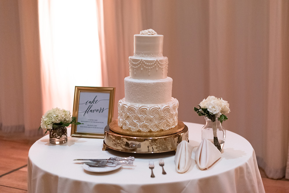 Four tiered white cake from Bethel Bakery at the Circuit Center