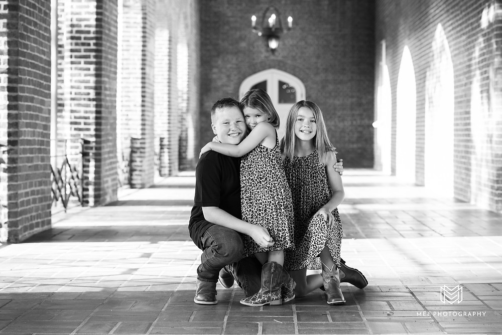 A black and white photo of a boy and his two sisters at Bethany College