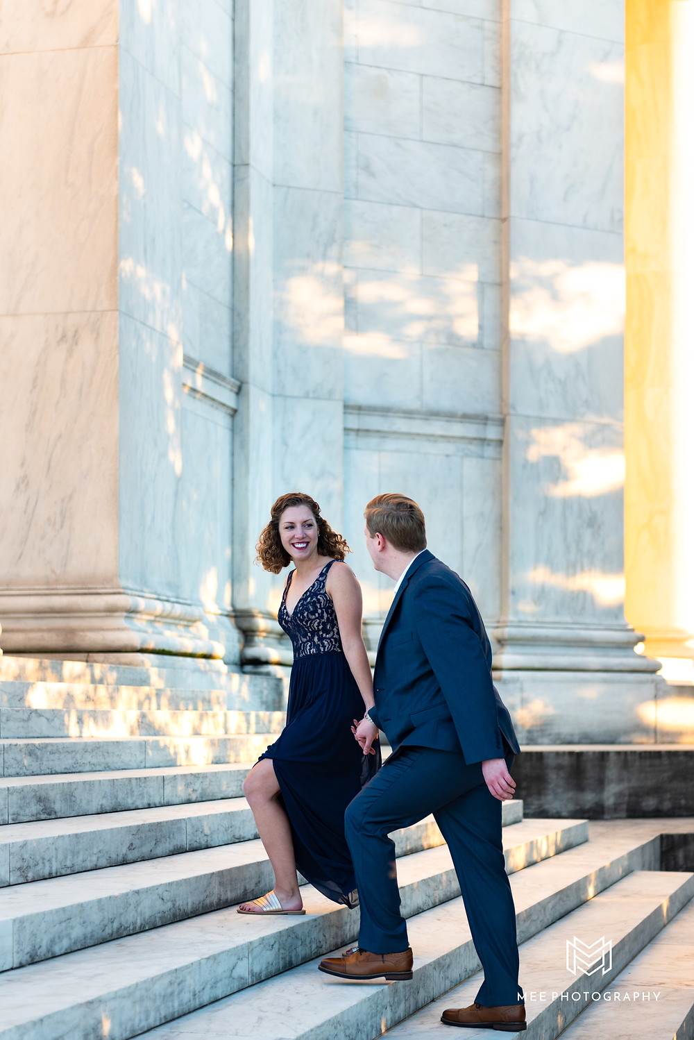 Washington D.C. engagement session ideas with the couple wearing a navy blue suit and gown