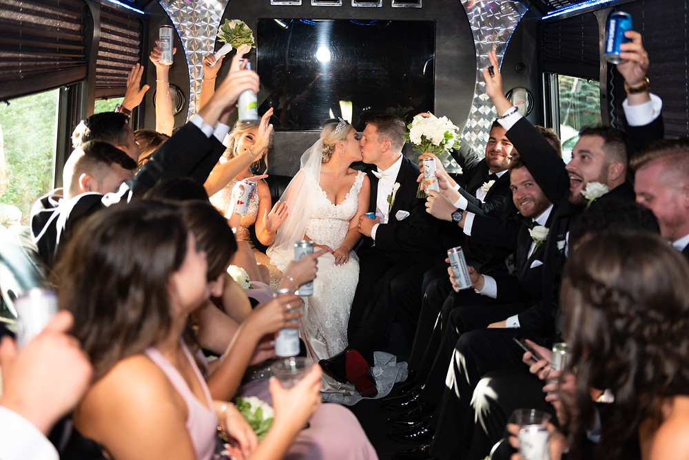 Bridal party cheering on the party bus in Pittsburgh