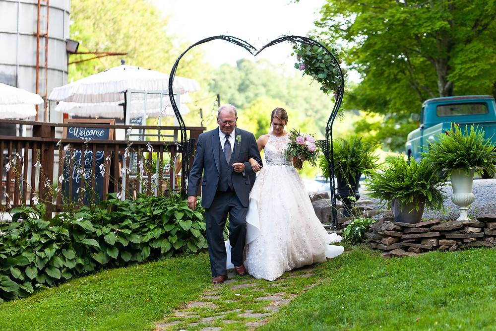 Father walking his daughter down the aisle at Chanteclaire Farm