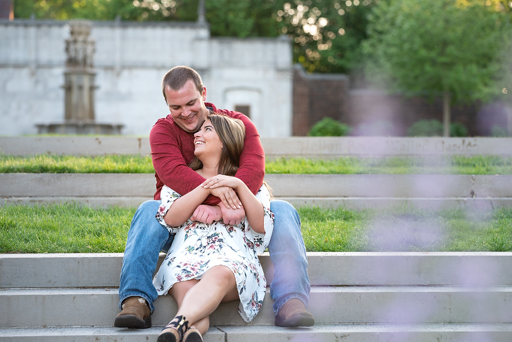 Mellon Park engagement with couple posed sitting on steps
