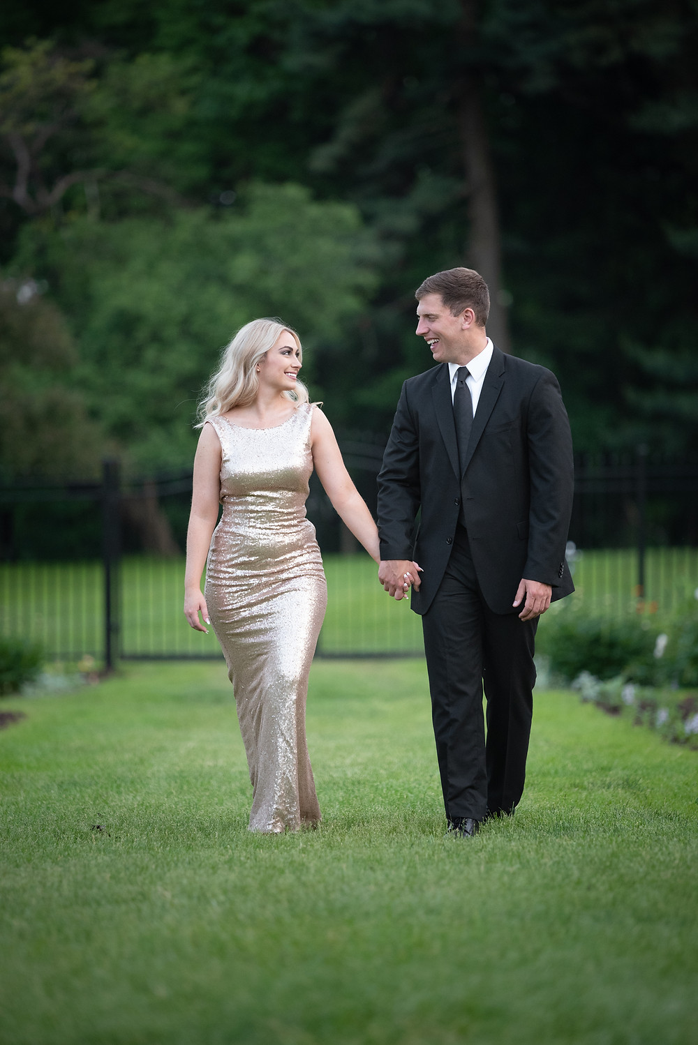 Newly engaged couple taking a stroll through the gardens at Hartwood Acres