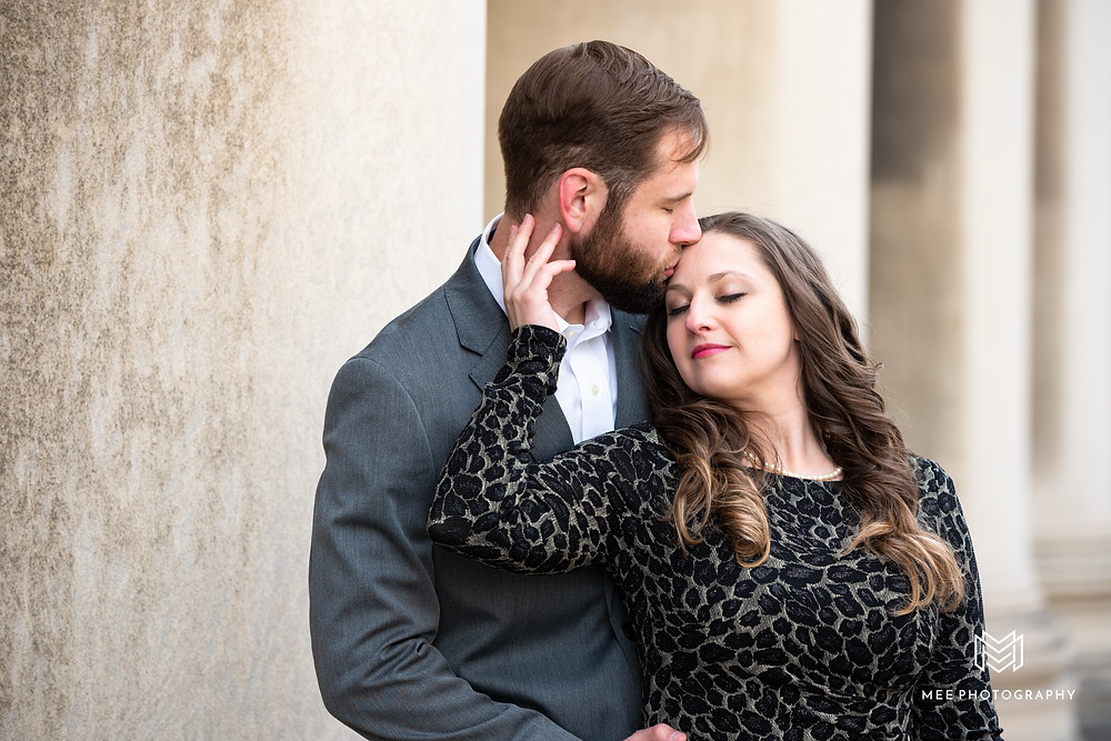 Guy kissing his fiance on her forehead during engagement photoshoot