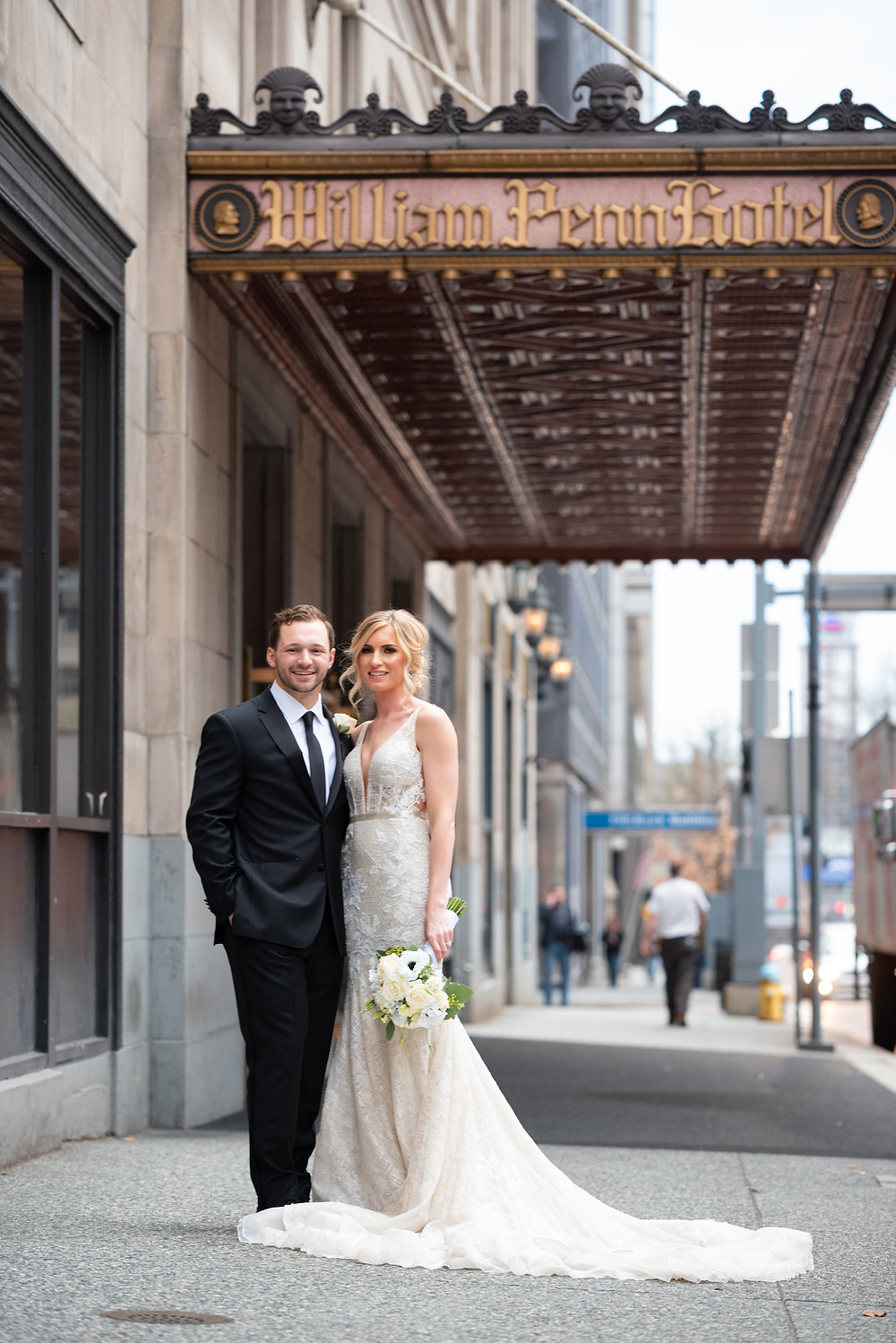 Wedding portraits outside of the Omni WIliam Penn Hotel in Pittsburgh
