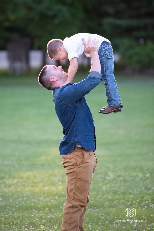 Dad picking up his son in the air during photo session at Hartwood Acres Park