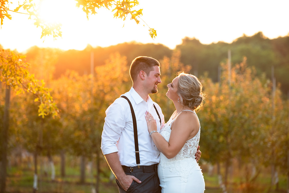 Bride and groom sunset portraits at Rich Farms Nursery