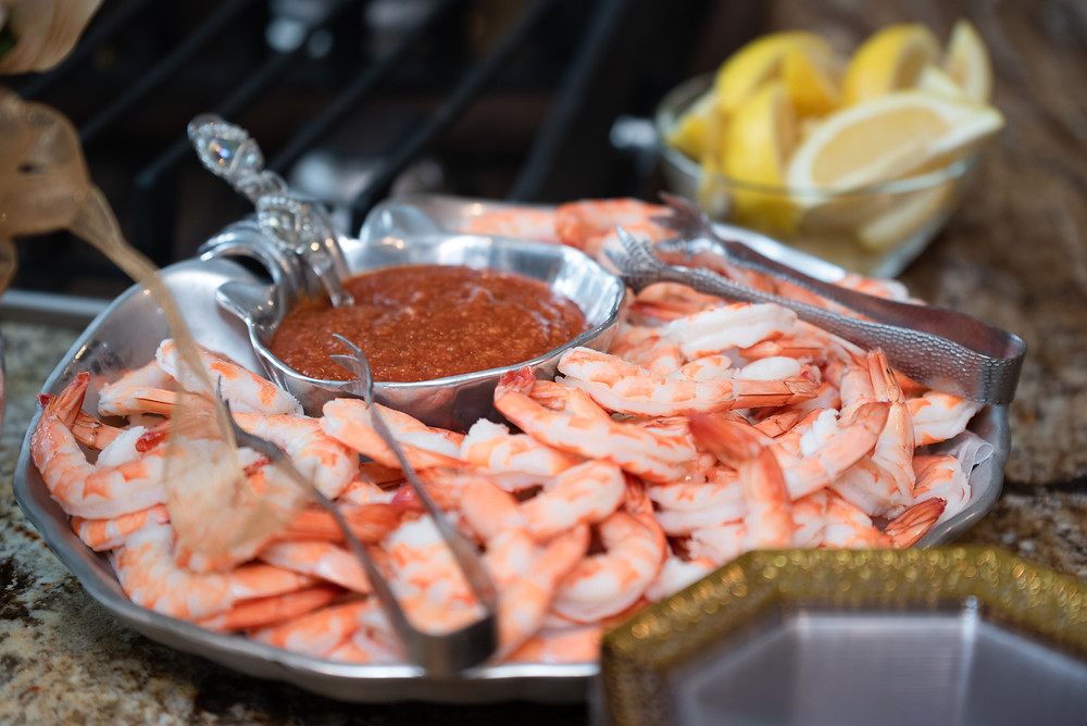 Tray of shrimp and cocktail sauce at a bridal shower