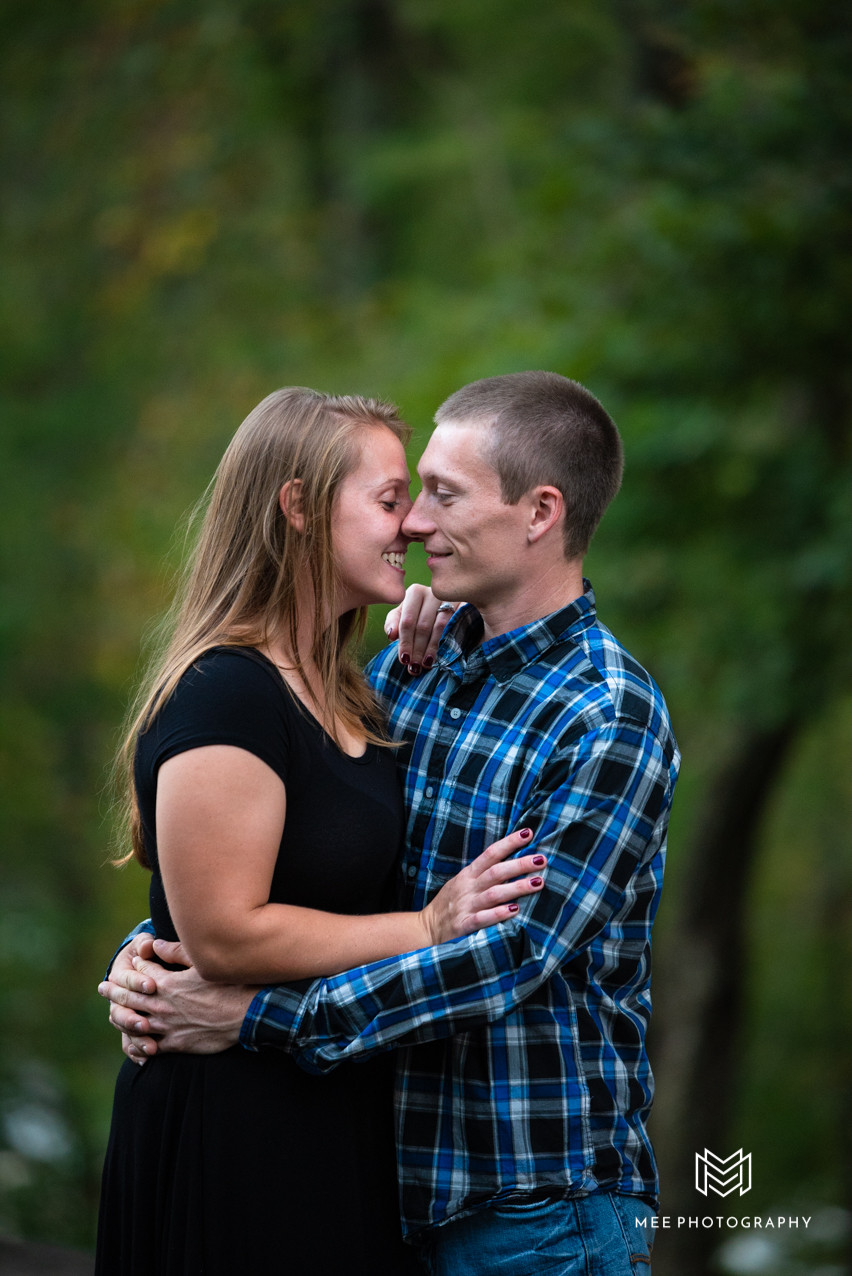 Couple embracing during their engagement session at Valley Falls State Park