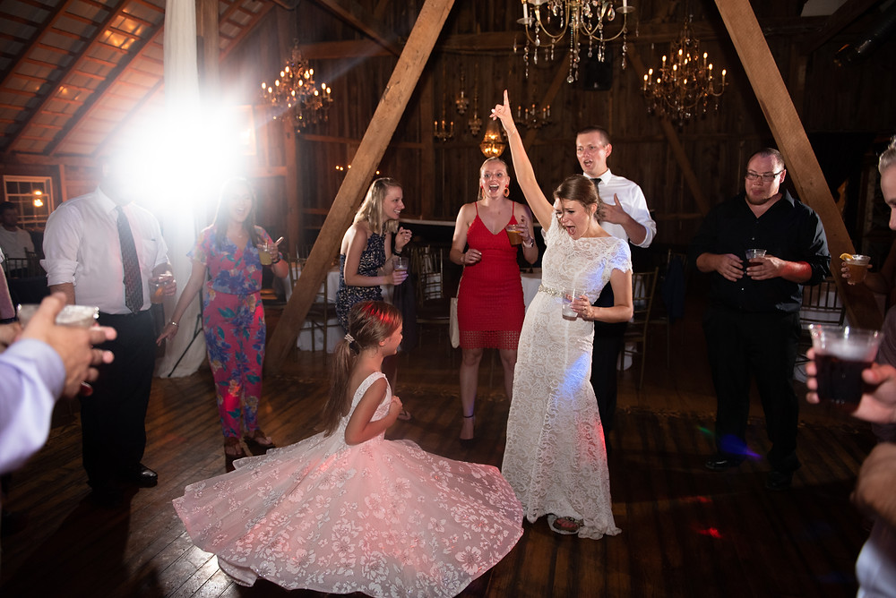 Flower girl dancing on the dance floor at Chanteclaire Farm