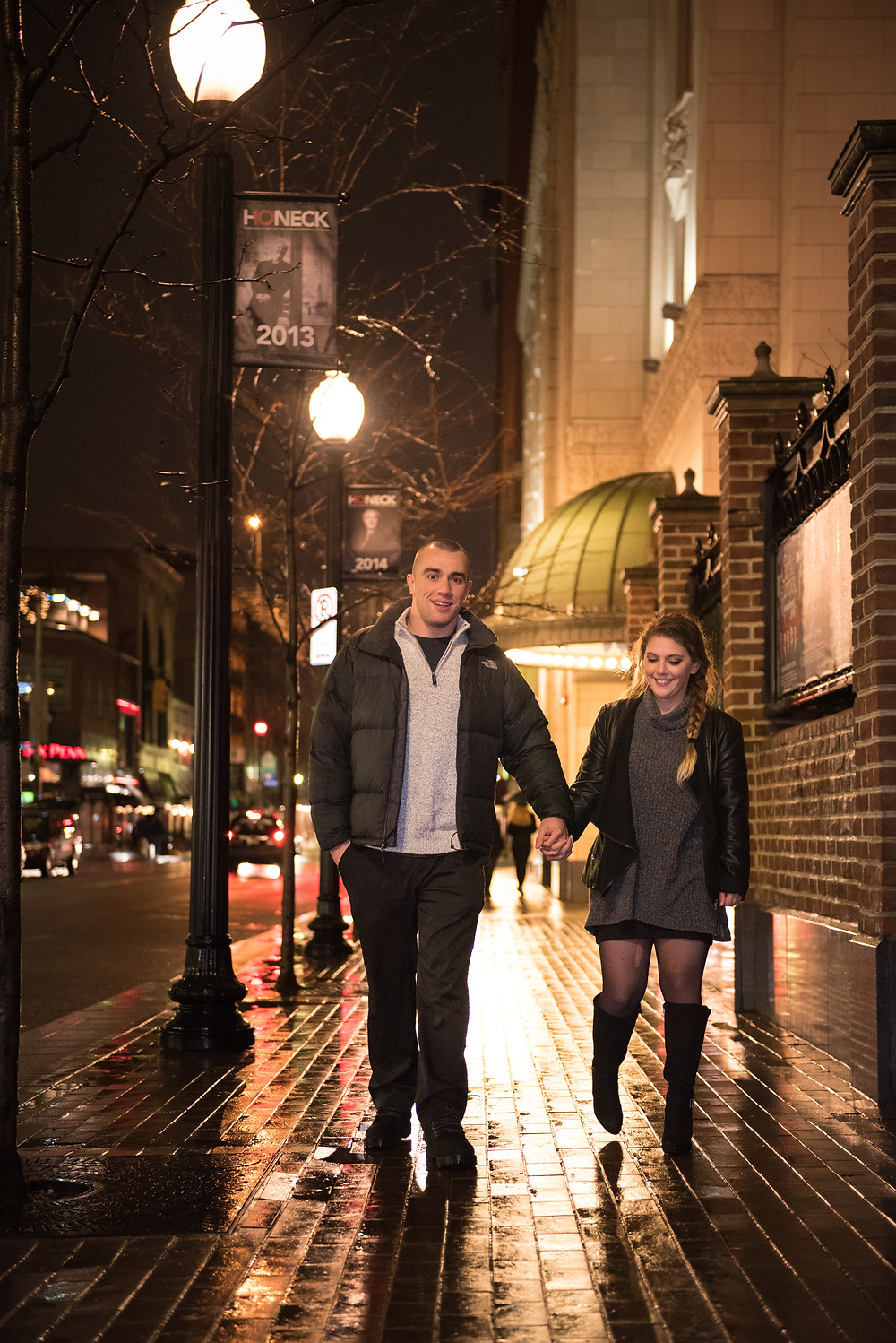 A winter engagement session in Pittsburgh, Pennsylvania. Couple walking and holding hands down the sidewalks of Pittsburgh