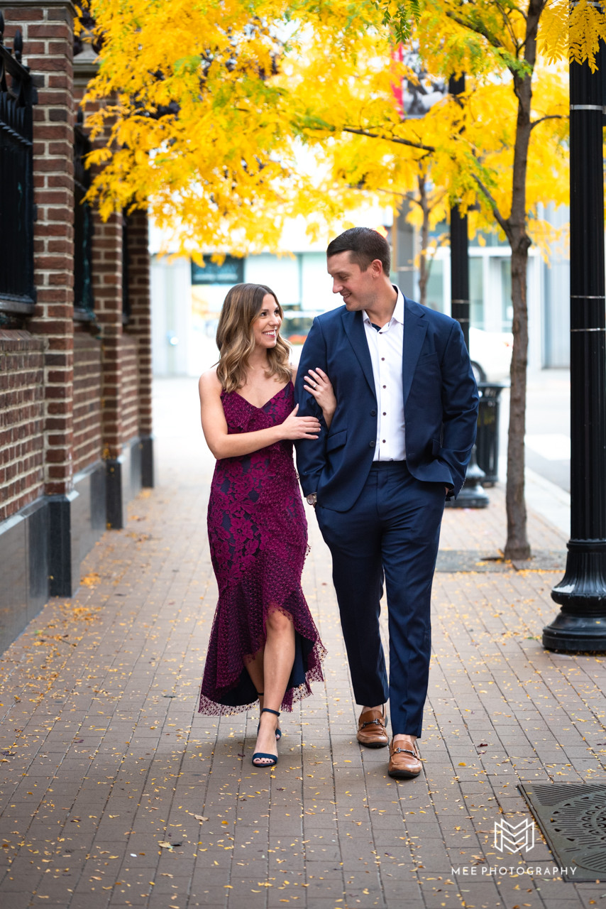 Downtown Pittsburgh fall engagement photos with the couple wearing burgundy and navy