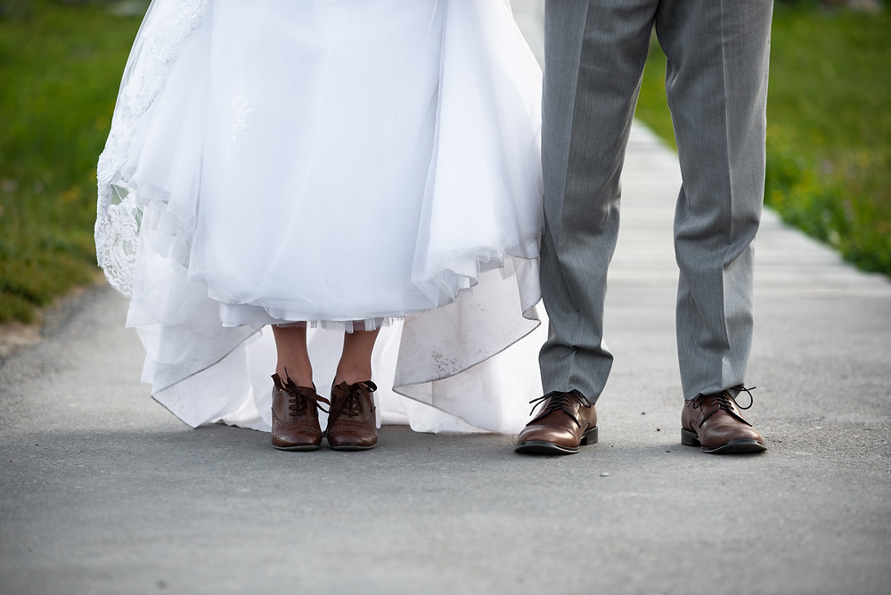Bride and groom wearing brown boots during their mountain elopement