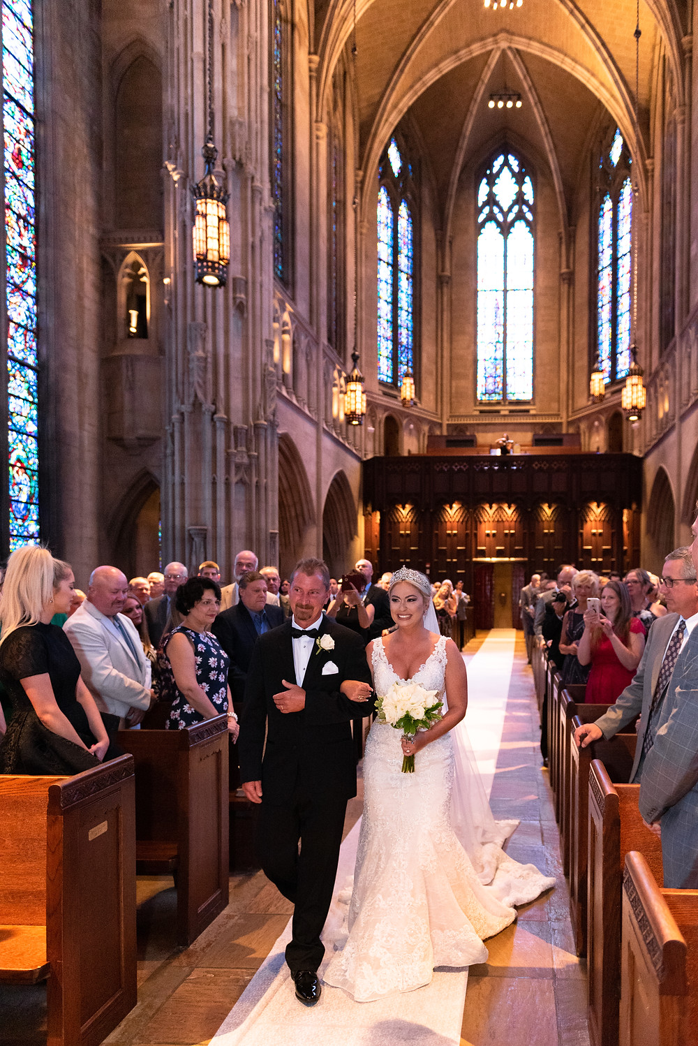 Bride's father walking her down the aisle at Heinz Chapel