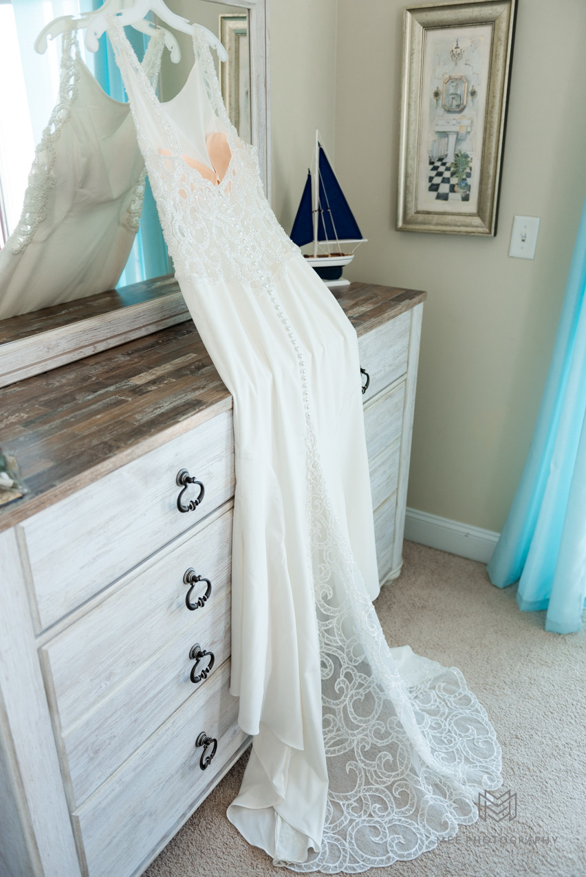 Wedding dress hanging on dresser