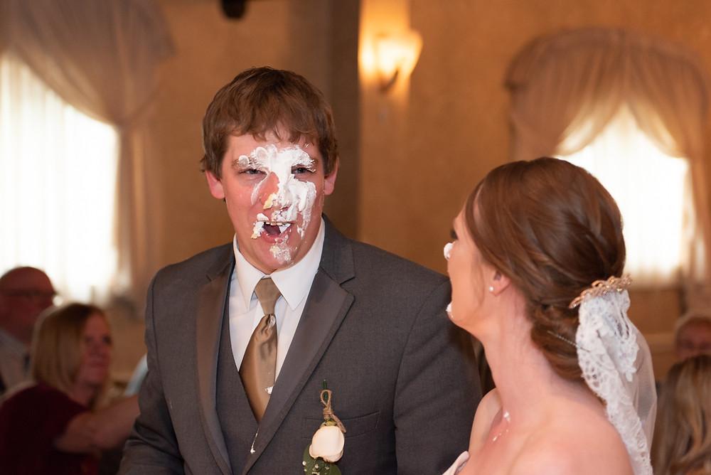 Cake smash at wedding reception