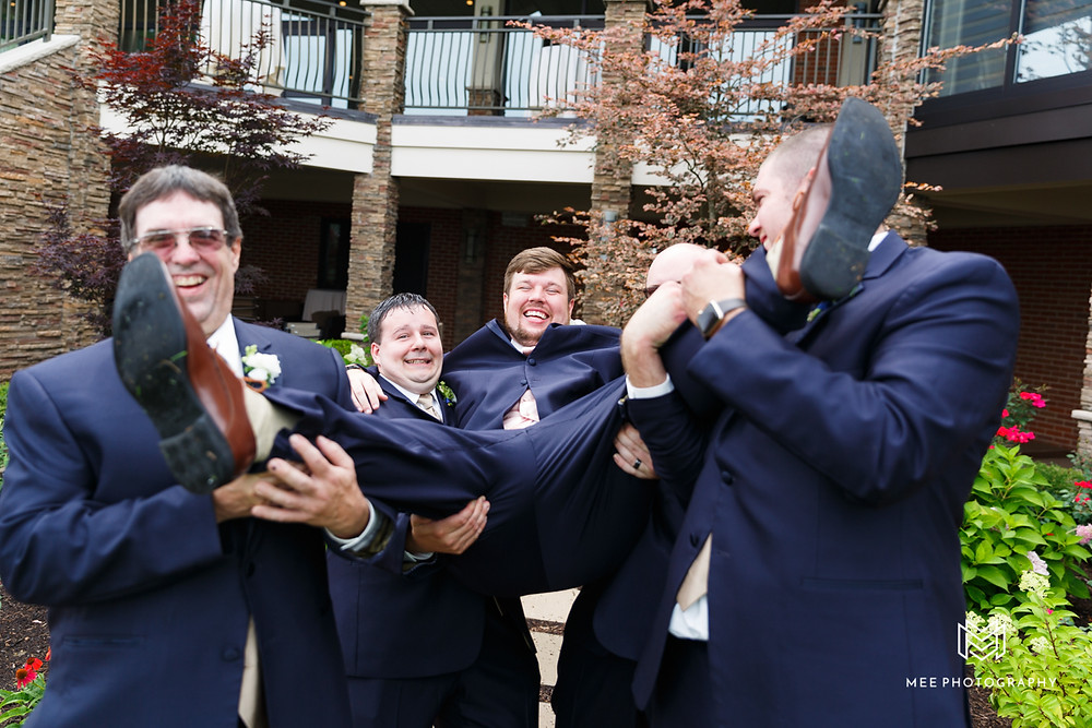 Groomsmen picking up groom at the Lake club in Poland, OH