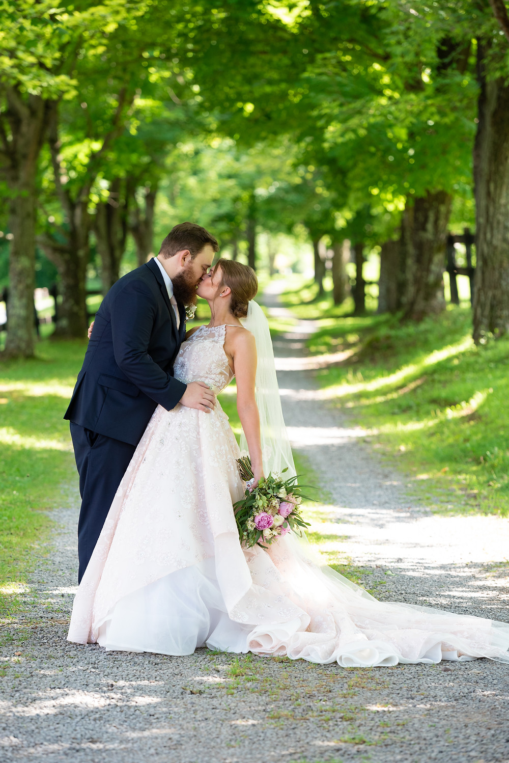 Bride and groom kiss at Chanteclaire Farm