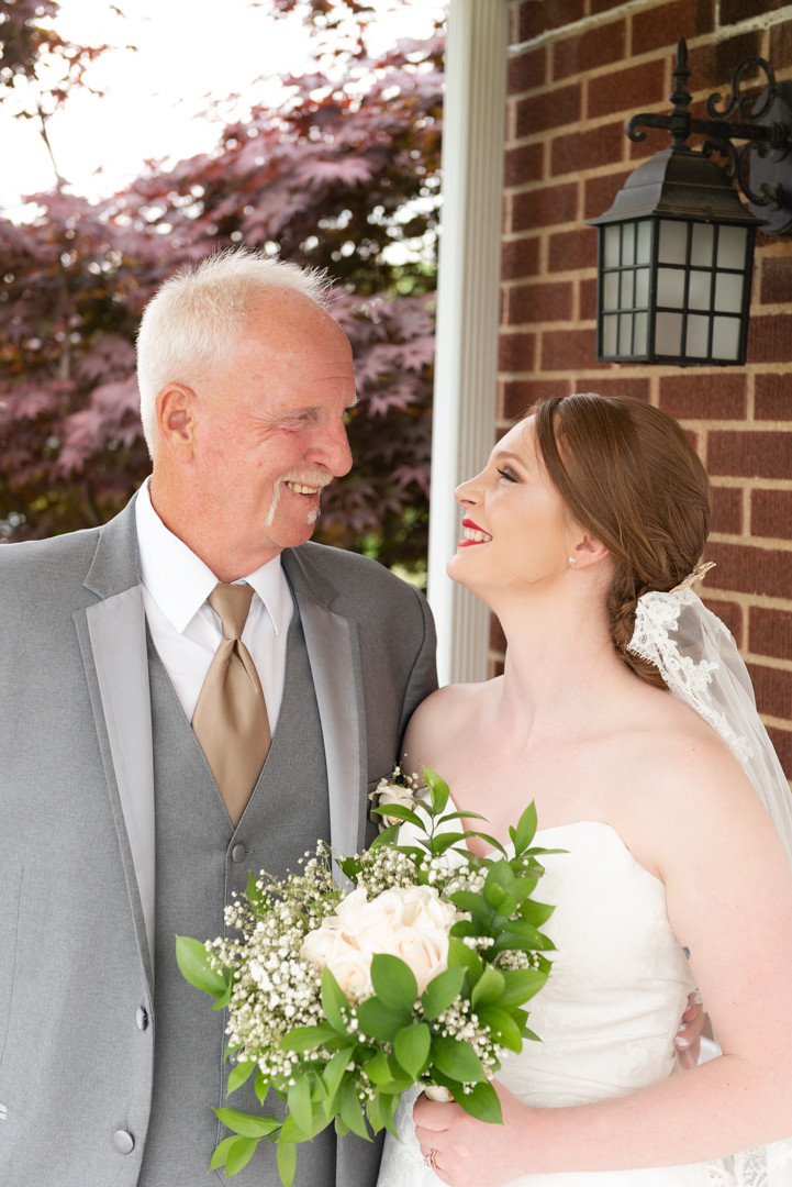 A portrait of of a bride and her dad
