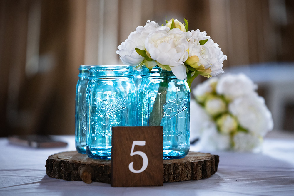 Blue mason jar wedding centerpiece with flowers at this barn wedding near Pittsburgh