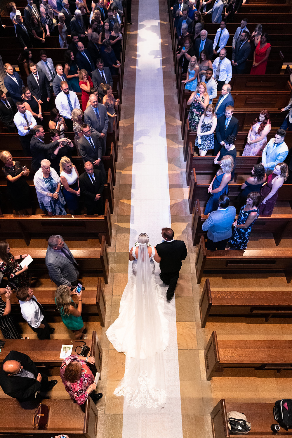 View of bride and father walking down aisle at Heinz Chapel from above