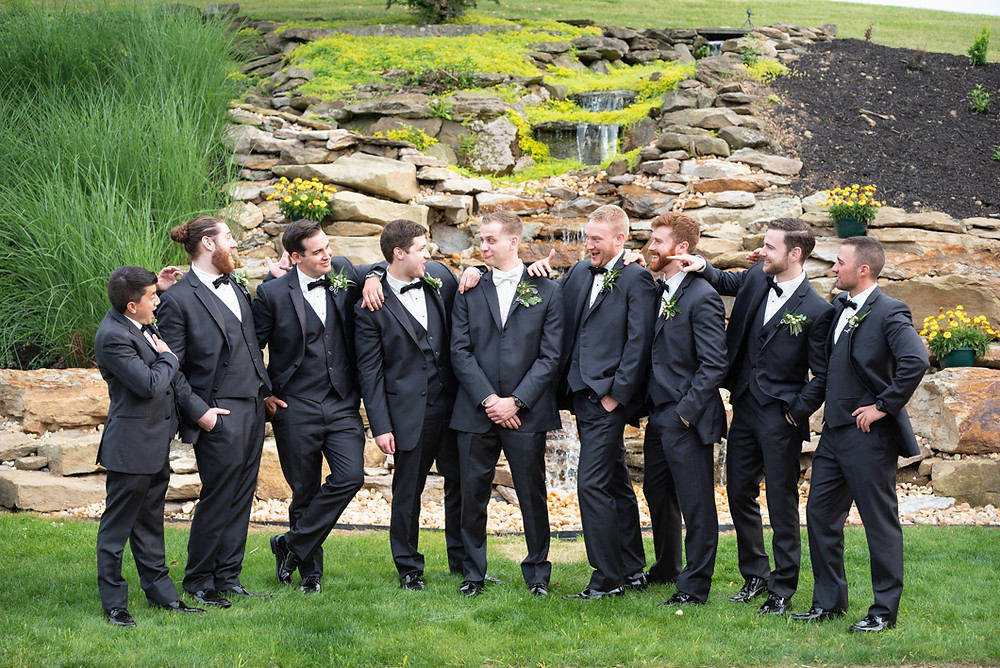 Groomsmen posing for a photo at Greystone Fields