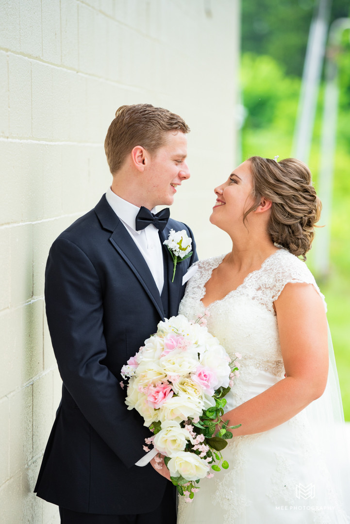 Newlyweds gazing into each other's eyes at a wedding in Chester, WV