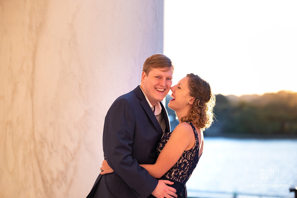 Couple laughing during their engagement shoot at the Thomas Jefferson Memorial in Washington DC