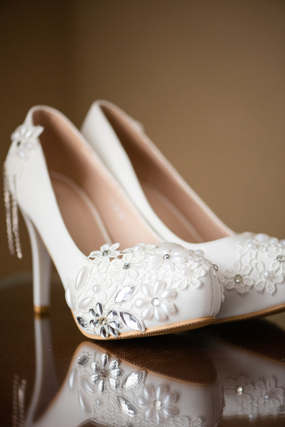 White bridal heels with flowers