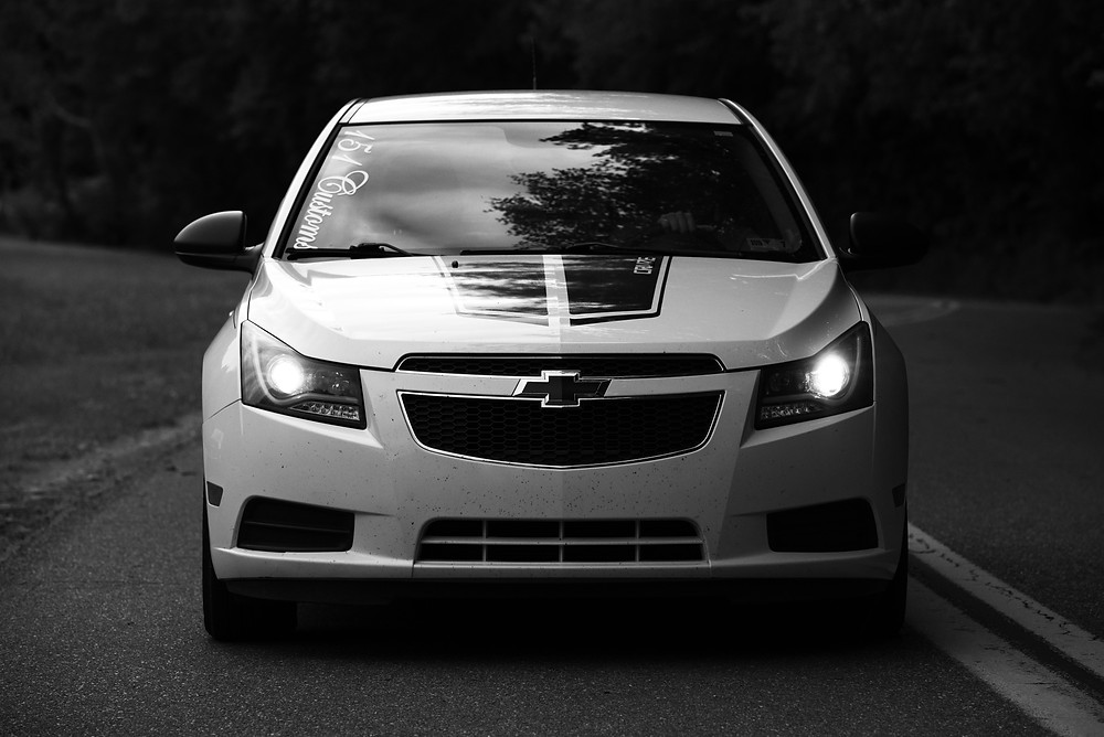 Black and white photograph of a 2014 chevy cobalt