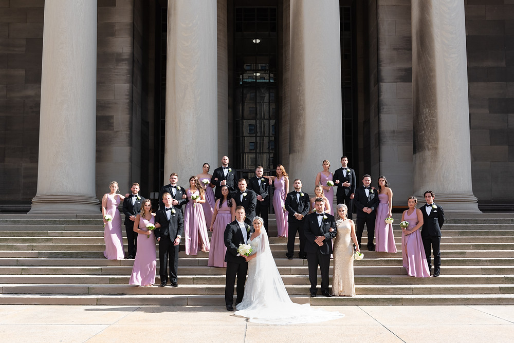 Bridal party posing on the steps of Mellon College of Science