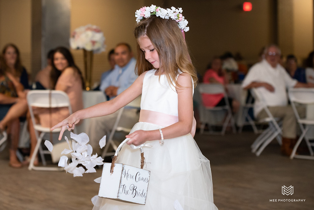 flower girl throwing white petals