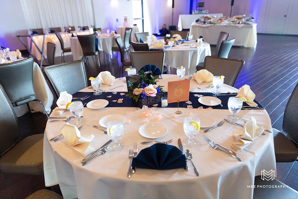 Reception at The Lake Club with purple uplighting