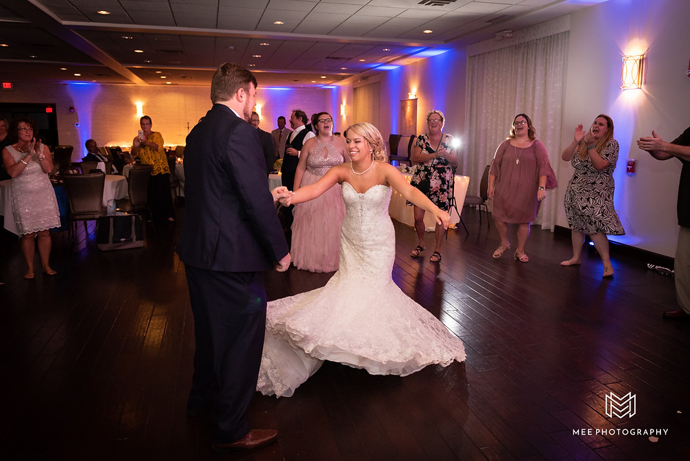 Groom spinning bride on the dance floor at the Lake Club of Ohio