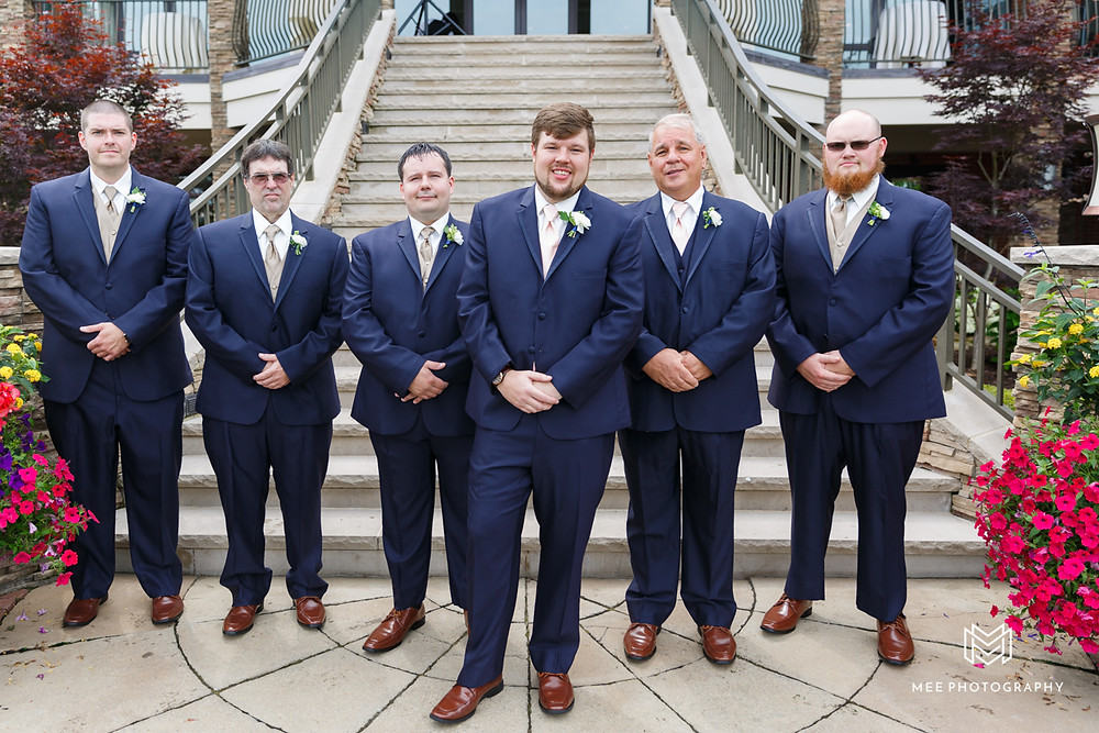 Groom and groomsmen in navy tux's and brown shoes