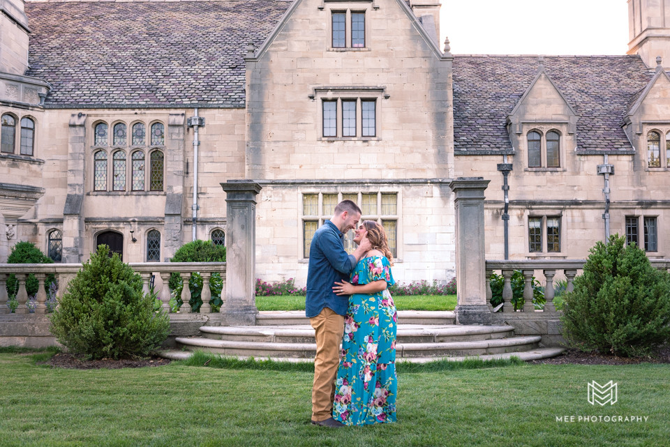 Maternity session at Hartwood Acres Park; Couple posed facing each other with manison in the background