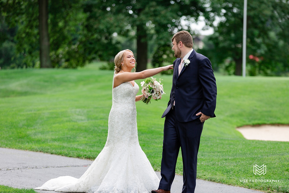 The groom seeing his bride for the first time