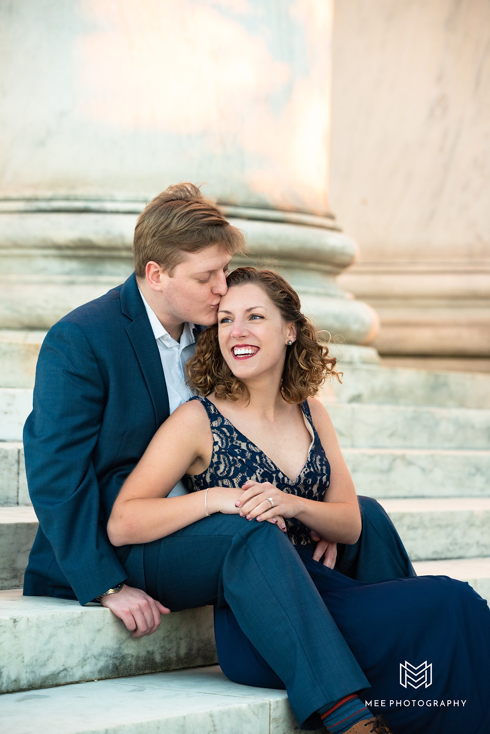 Couple posed sitting on the marble steps of the Thomas Jefferson Memorial