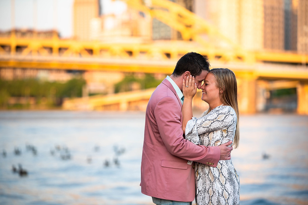 Engagment session with yellow bridges and Pittsburgh in the background