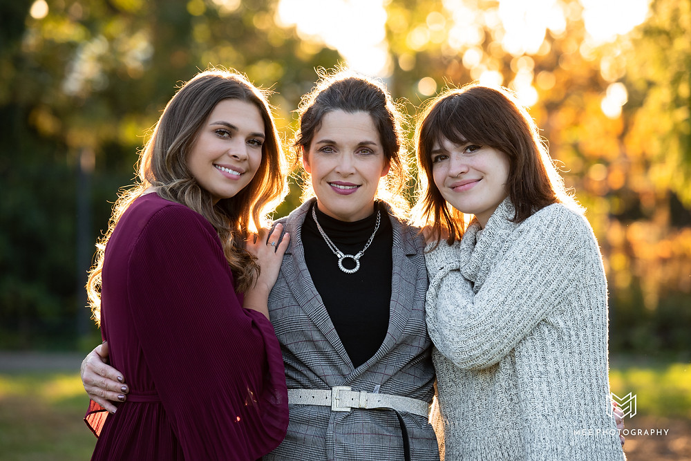 Fall portrait of a mother and two daughters at Phipps Conservatory in Pittsburgh