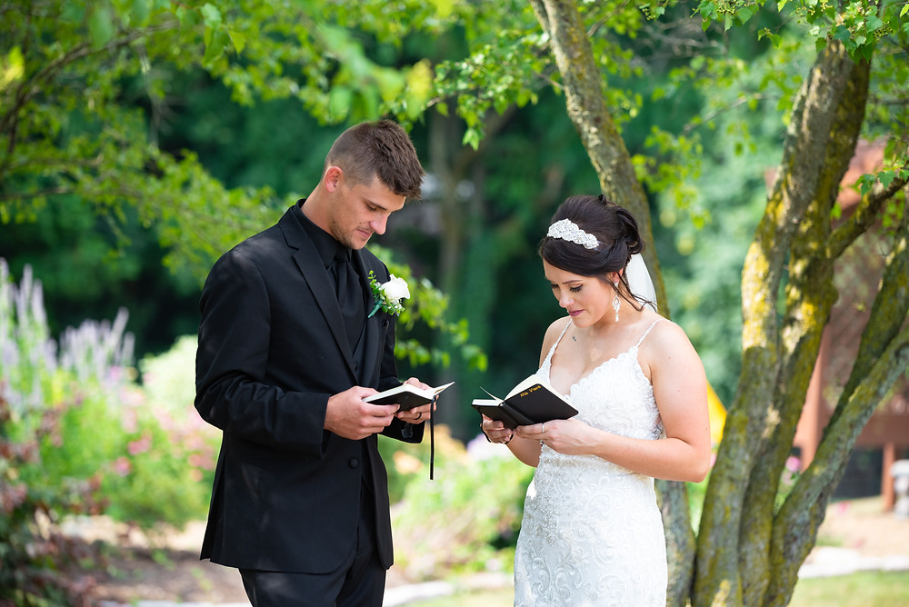 Bride and groom reading letters to each other at the Beaver Station