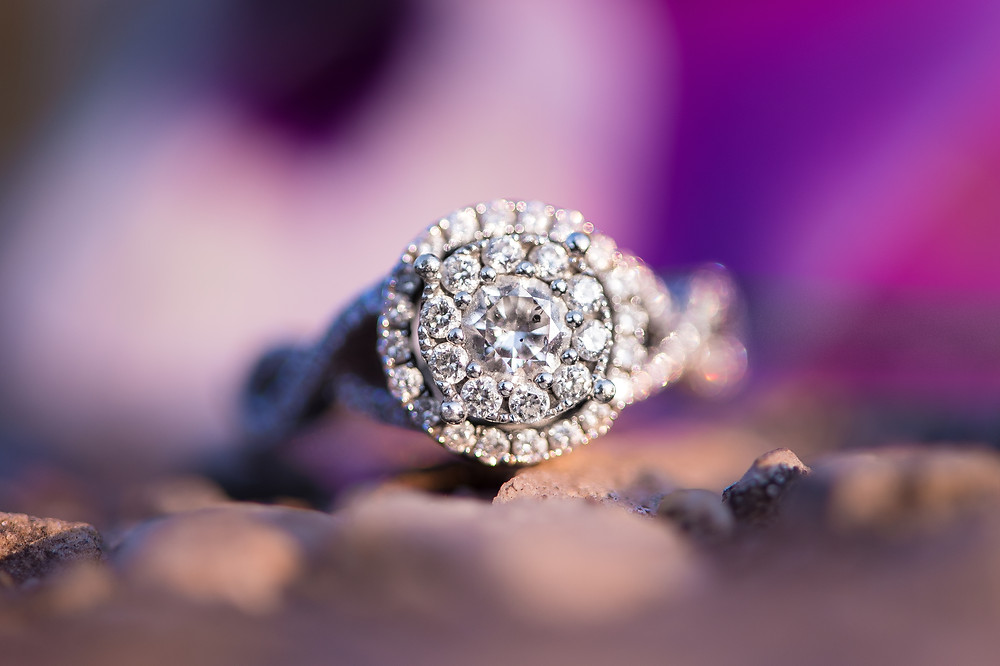 Detail shot of a gorgeous engagement ring with a double halo.