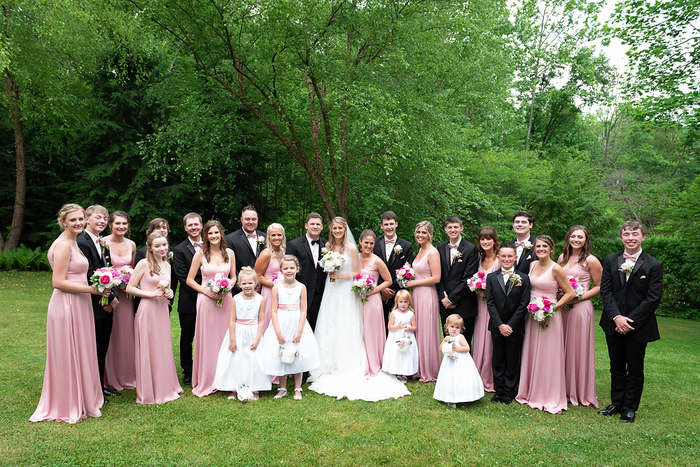 Twenty person bridal party in black, pink, and white with flower girls