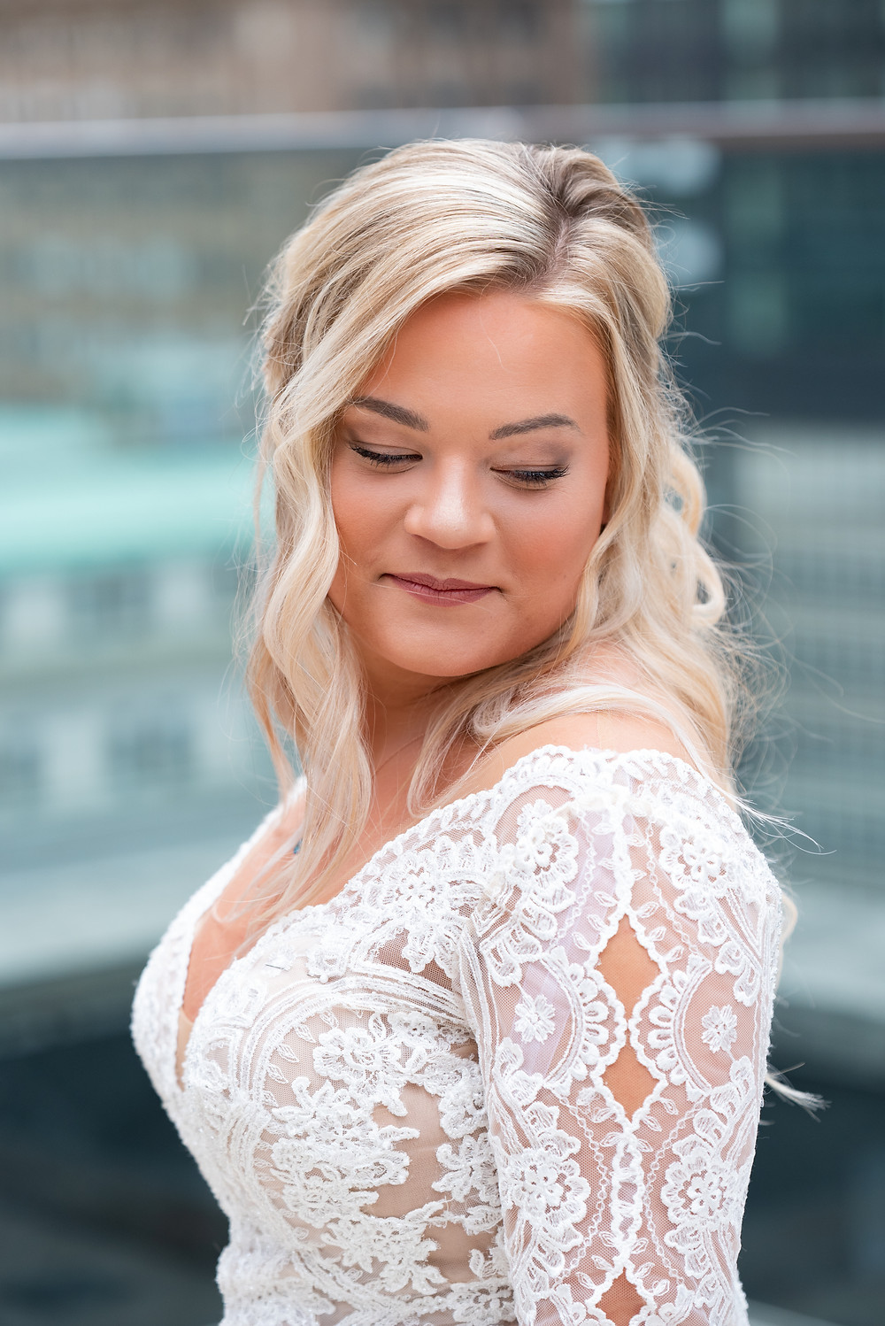 Bridal portrait on the roof of hotel Monaco with the Pittsburgh skyline in the background