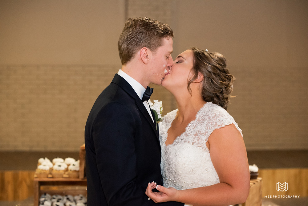 Kissing after getting cake all over each other
