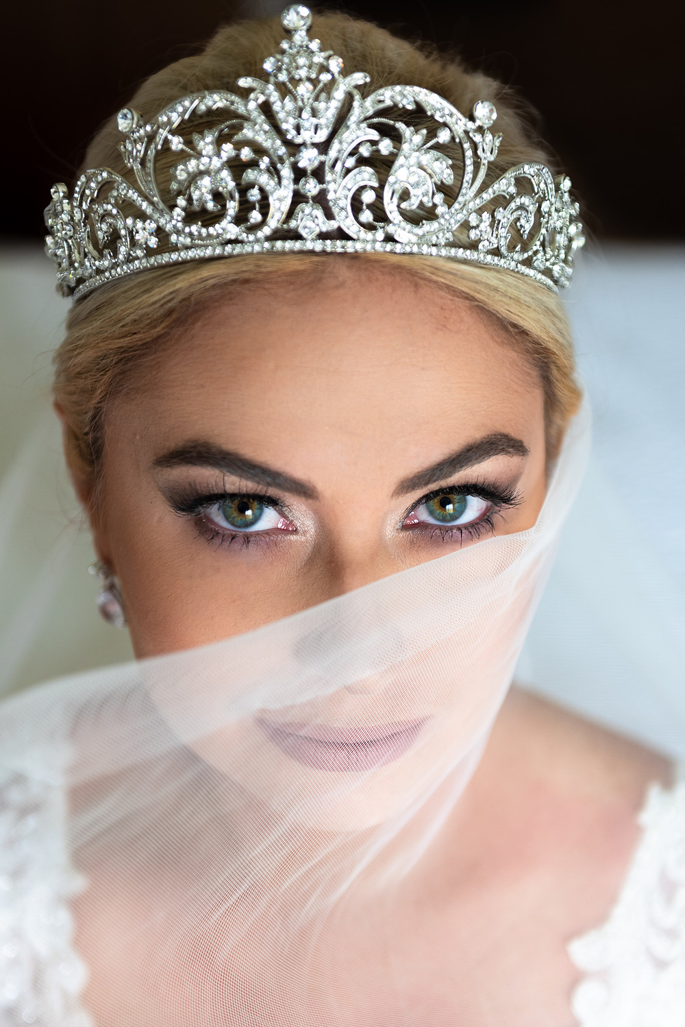 Bridal eye makeup with veil and crown